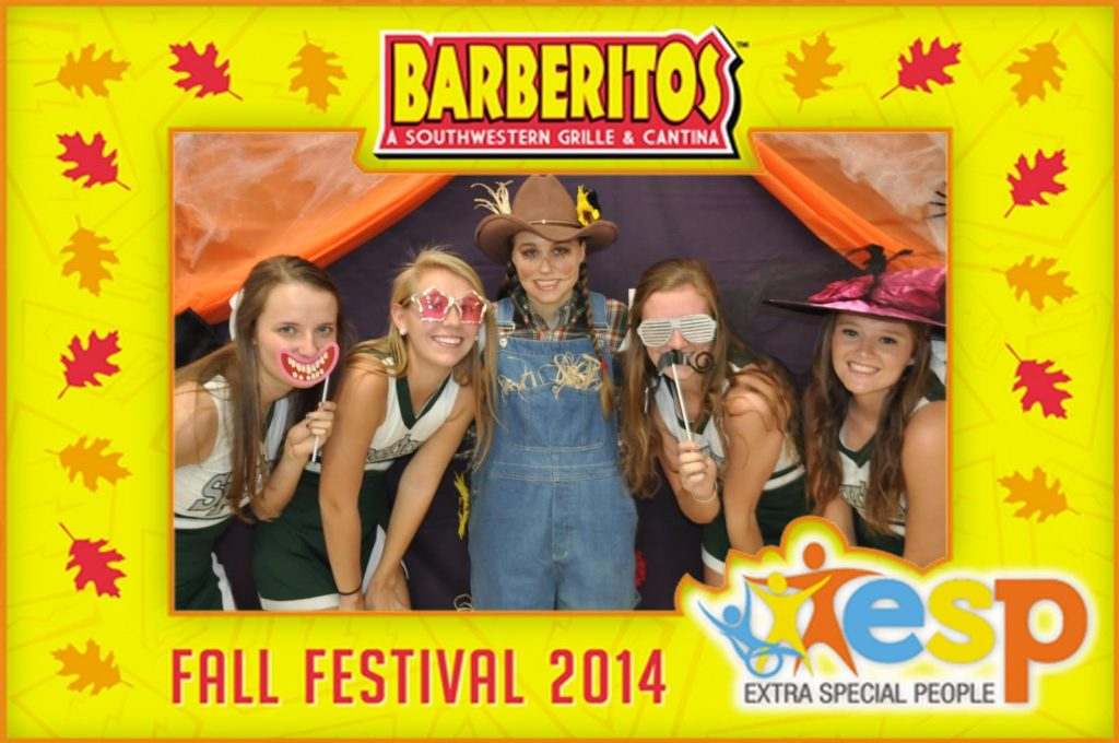 a group of girls pose for a mag-nificent photo at a fall festival