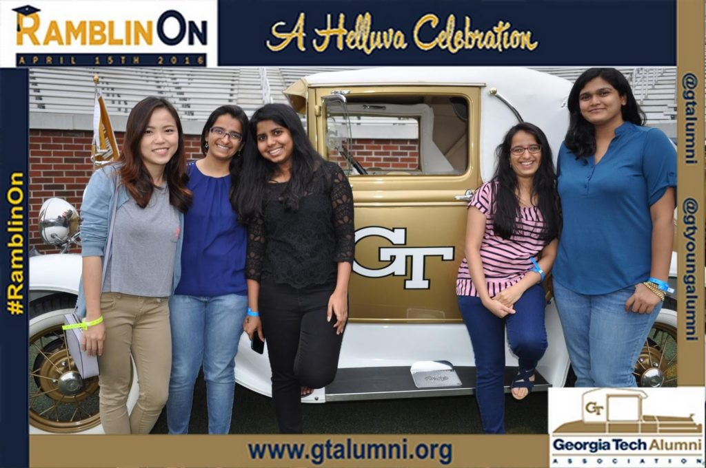 5 girls pose for a mag-nificent photo with the ramblin wreck car at an alumni event