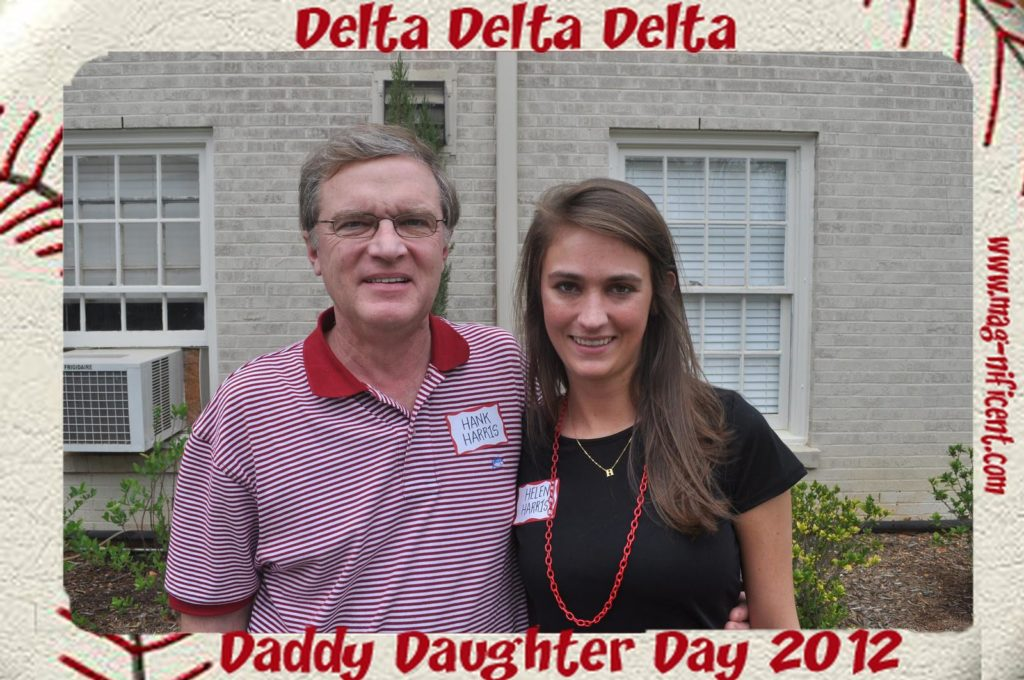 Father and daughter pose for a mag-nificent picture at a sorority event