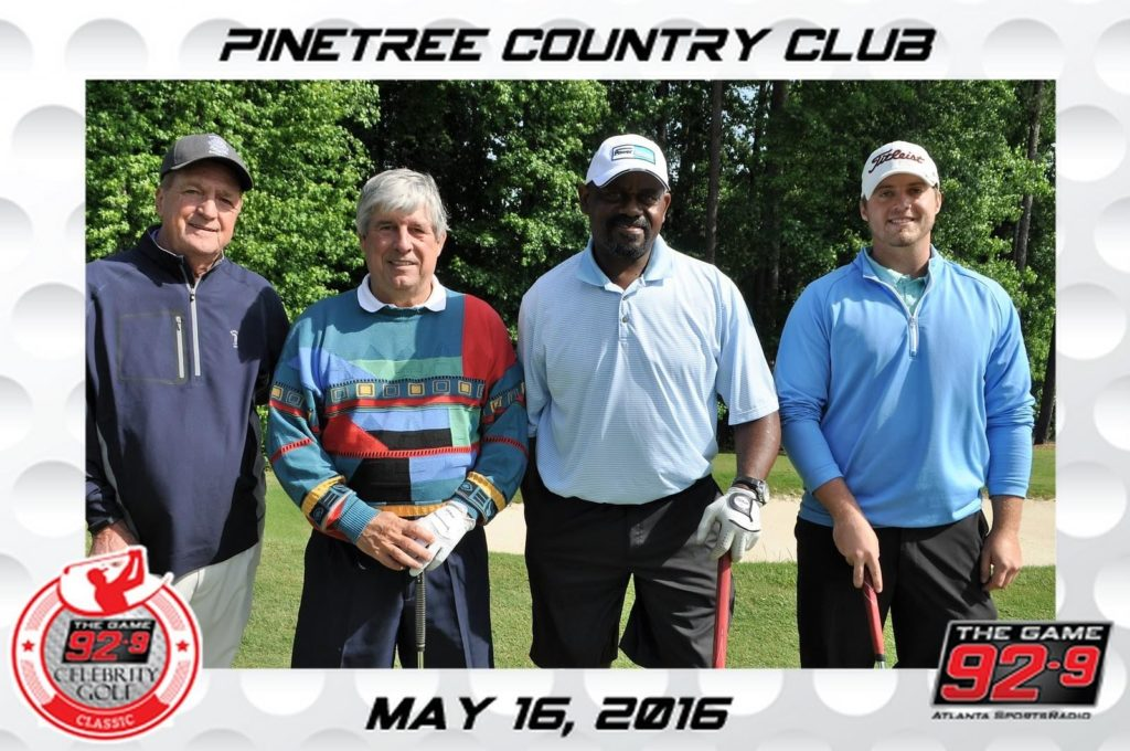 four guys pose for a mag-nificent picture at pinetree country club