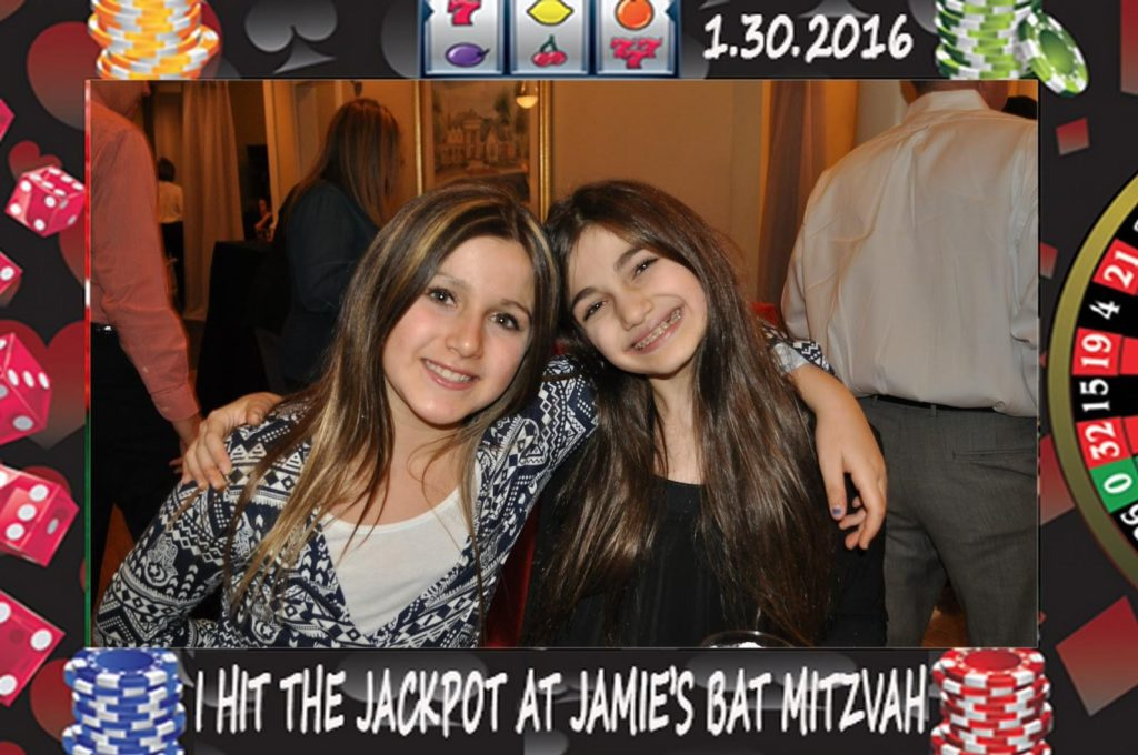two kids pose at a bat mitzvah for a mag-nificent photo
