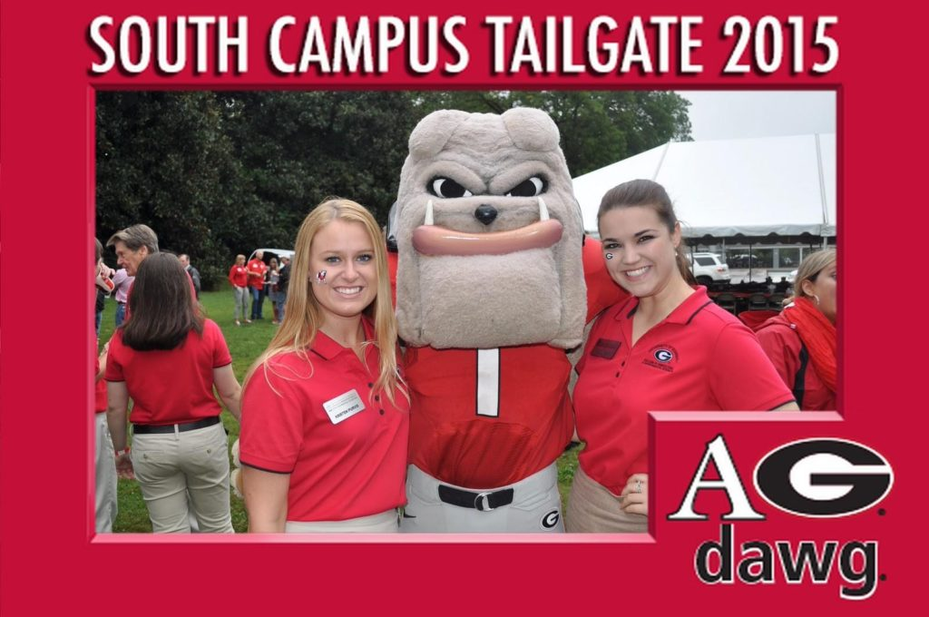 2 girls pose for a mag-nificent photo with the UGA mascot at a tailgate