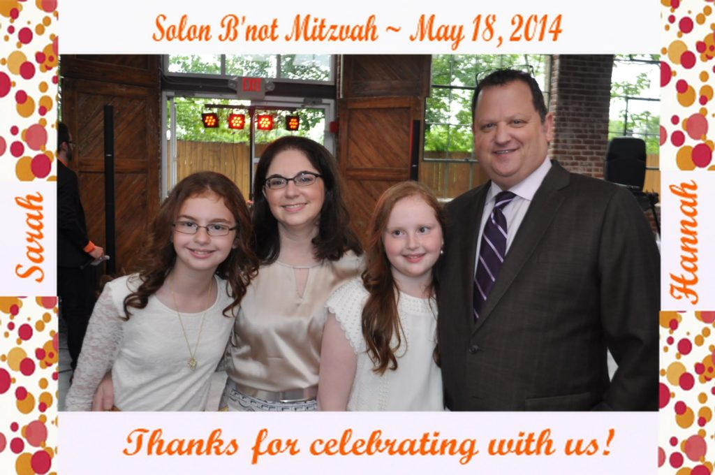 a family poses for a picture at a bat mitzvah