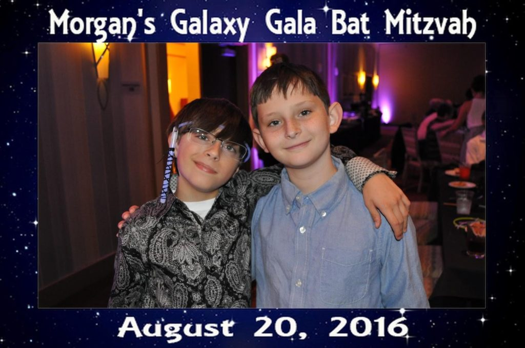 two boys pose for a picture at a bat mitzvah