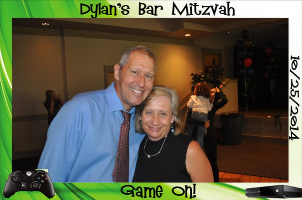two people pose for a picture at a bar mitzvah