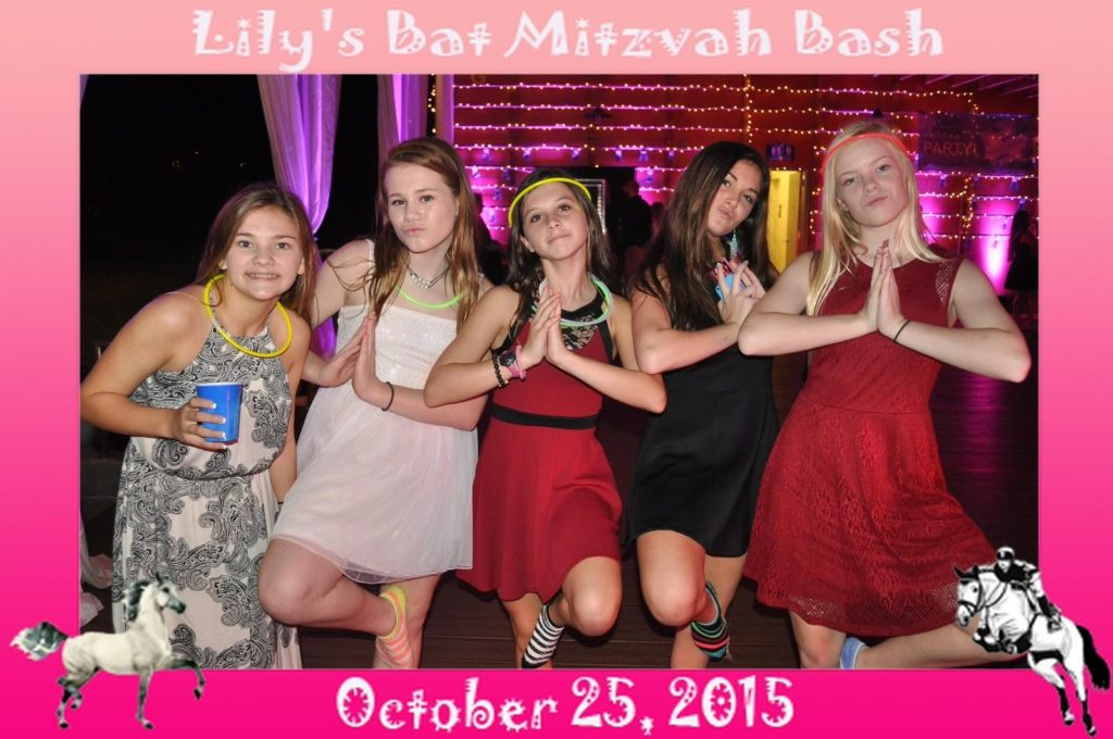 a group of girls pose for a picture at a bat mitzvah