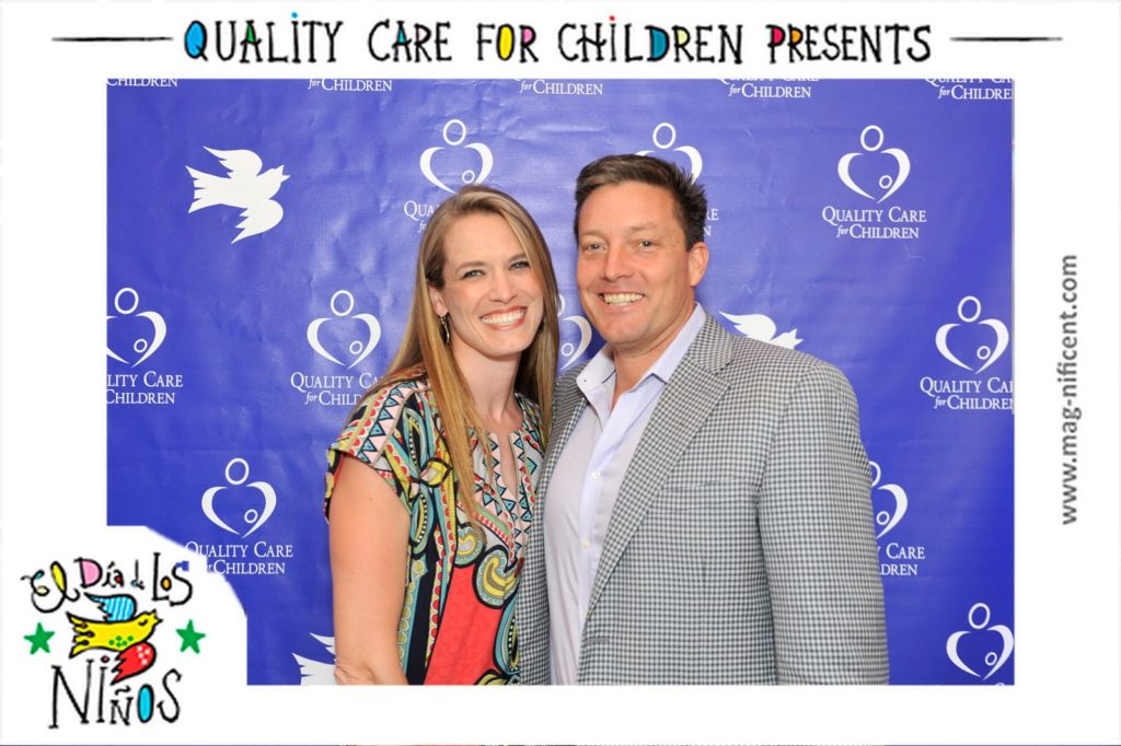 a man and woman pose for a mag-nificent picture at an event benefitting children's health