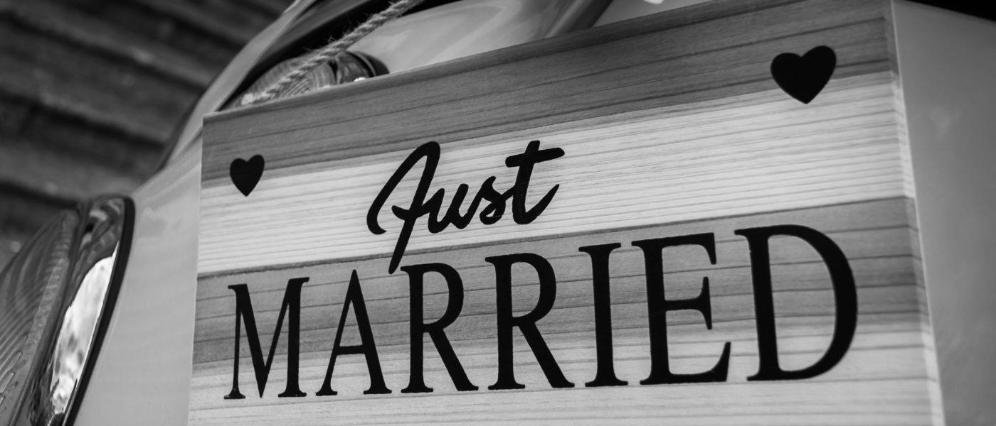 "Black and white board saying ""Just Married"""