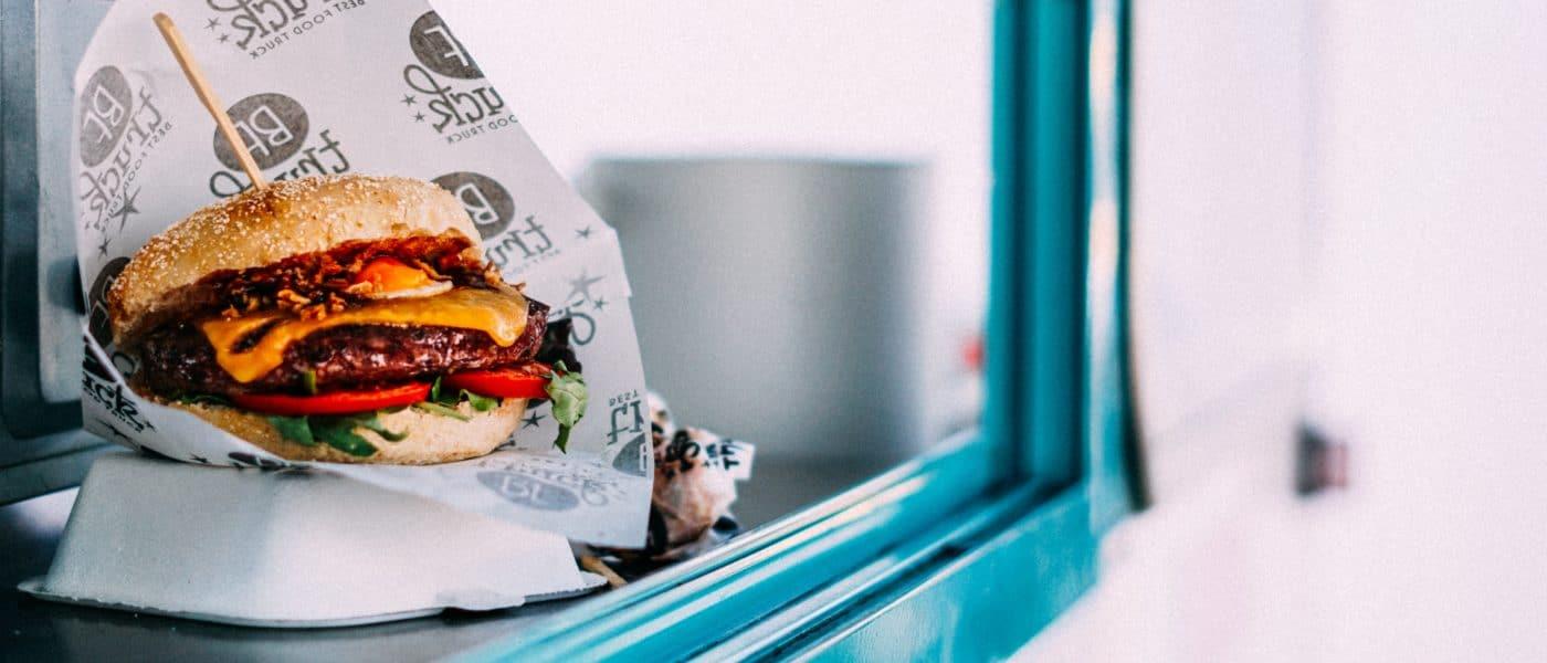 Cheeseburger at a food truck window.