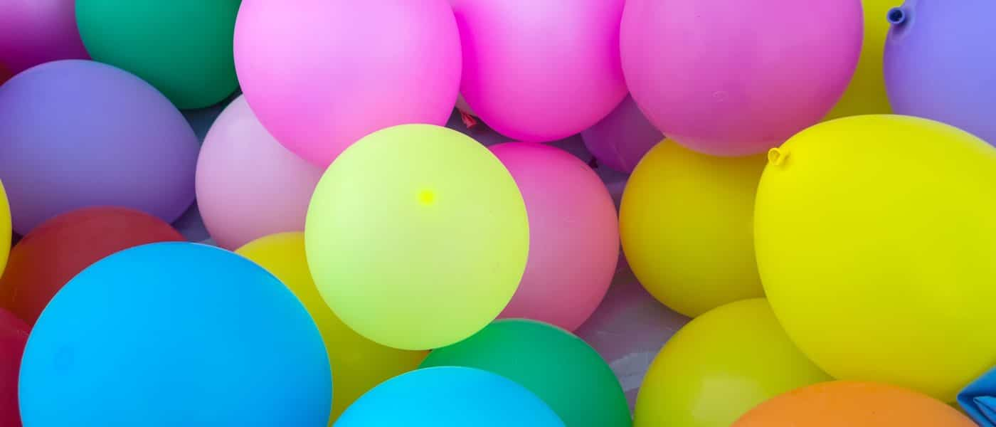 Bunched group of colorful balloons.