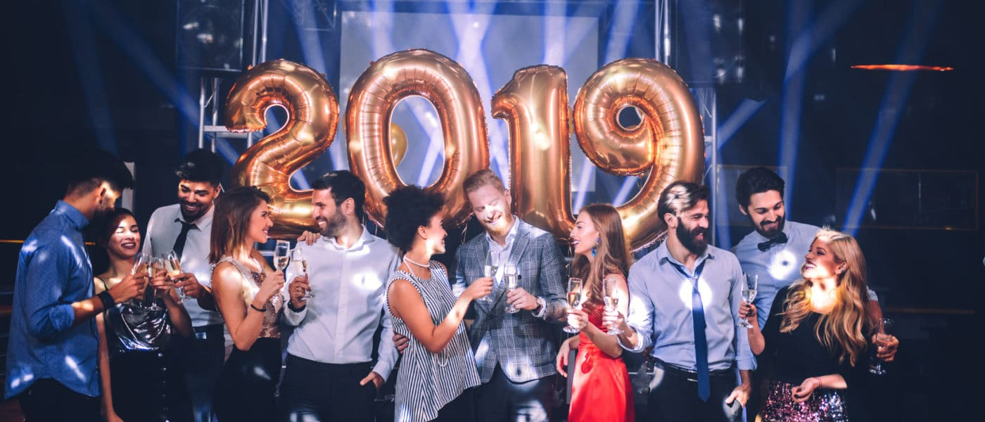 Photo of friends celebrating at a NYE party.