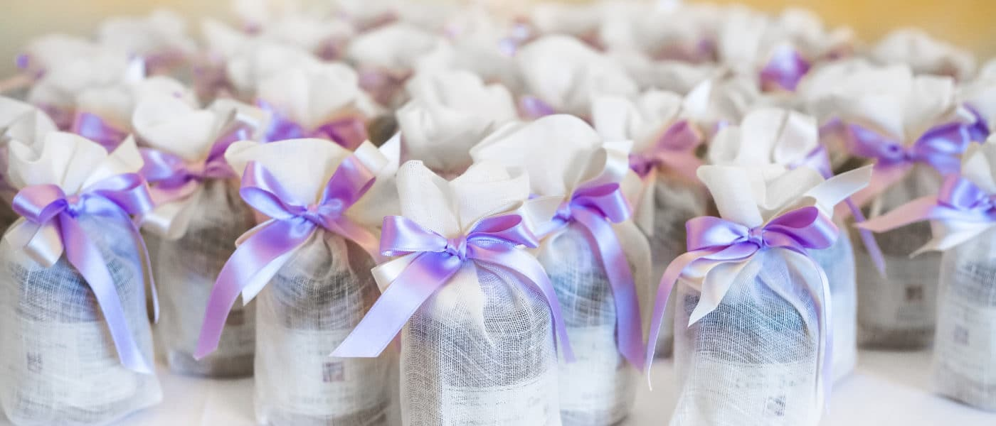 Wedding favors neatly organized on a table.
