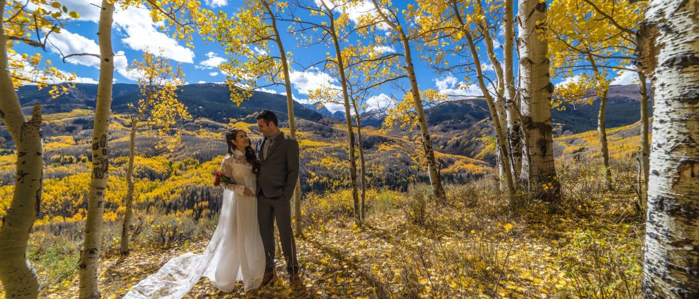Wedding photo of a bride and groom in the mountains outside of Denver.
